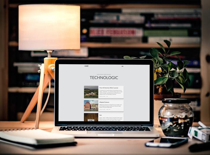 A MacBook showing a website using the aether theme
